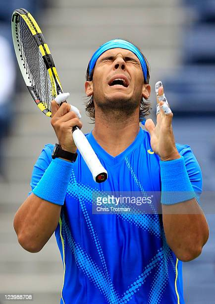 Rafael Nadal of Spain reacts to a play against Gilles Muller of Luxembourg during Day Ten of the 2011 US Open at the USTA Billie Jean King National...