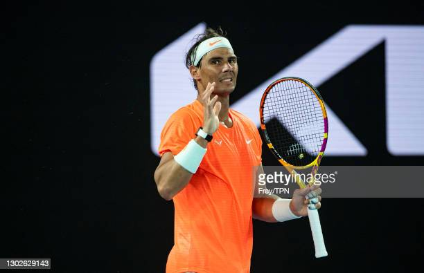 Rafael Nadal of Spain reacts to missing a shot against Stefanos Tsitsipas of Greece during day 10 of the 2021 Australian Open at Melbourne Park on...