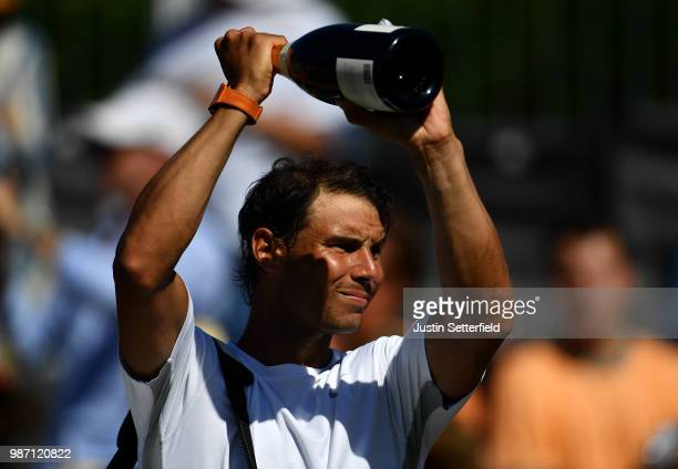 Rafael Nadal of Spain reacts to the fans after losing to Lucas Pouille of France during the Aspall Tennis Classic at Hurlingham on June 29 2018 in...