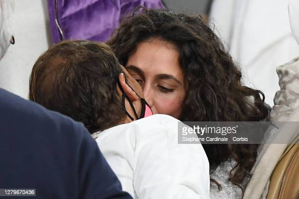 Rafael Nadal of Spain receives a congratulatory kiss from his wife Xisca Perello after his victory against Novak Djokovic of Serbia in the Singles...