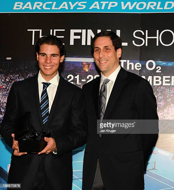 Rafael Nadal of Spain receives his trophy from CEO of the ATP Adam Helfant during the Barclays ATP World Tour Finals Media Day at the County Hall...