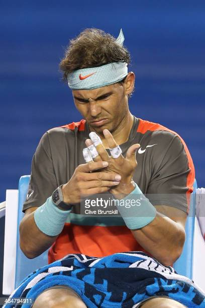 Rafael Nadal of Spain receives medical attention on a blister on his hand during a medical timeout in his semifinal match against Roger Federer of...