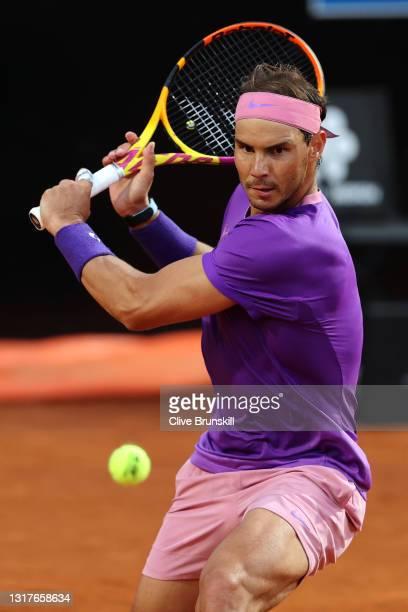 Rafael Nadal of Spain returns a backhand on day 5 of the Internazionali BNL d'Italia match between Rafael Nadal of Spain and Jannik Sinner of Italy...