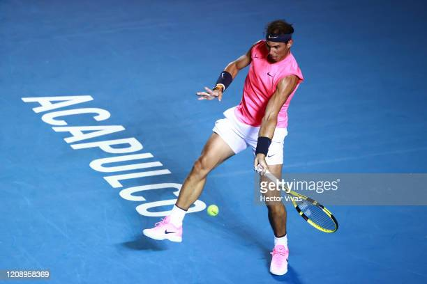 Rafael Nadal of Spain returns a ball against Miomir Kecmanovic of Serbia during their men's singles match on day three of the ATP Mexican Open 2020...
