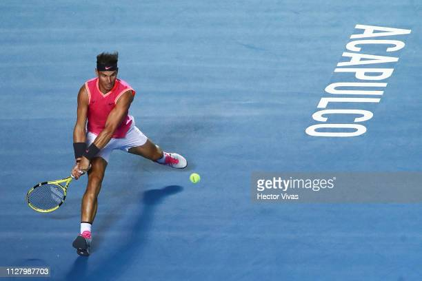 Rafael Nadal of Spain returns a ball during the match against Nick Kyrgios of Australia as part of the day 3 of the Telcel Mexican Open 2019 at...