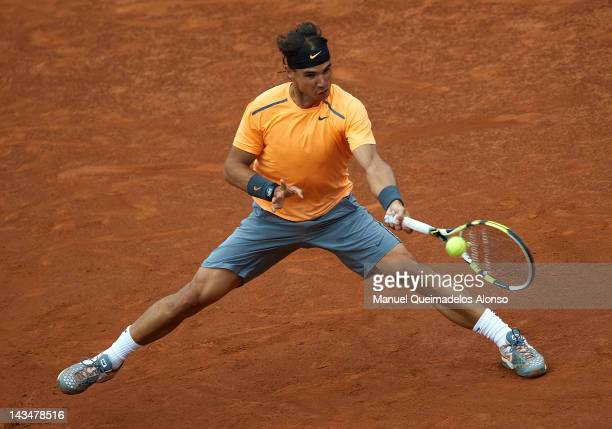 Rafael Nadal of Spain returns a ball to Janko Tipsarevic of Serbia during their match on day 5 of the ATP 500 World Tour Barcelona Open Banco...