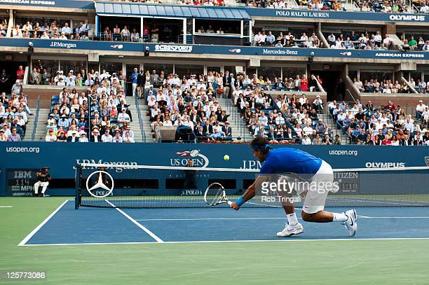Rafael Nadal of Spain returns a ball to Novak Djokovic of Serbia during the Men's Final on Day Fifteen of the 2011 US Open at the USTA Billie Jean...