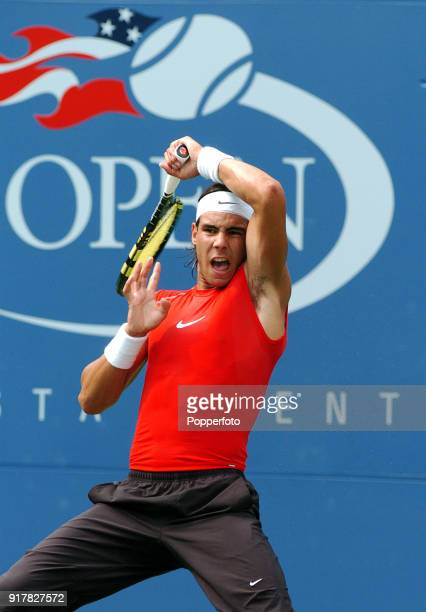 Rafael Nadal of Spain returns a forehand to Bobby Reynolds of the USA during their first round match at the US Open at the USTA National Tennis...