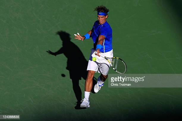 Rafael Nadal of Spain returns a shot against Andy Roddick of the United States during Day Twelve of the 2011 US Open at the USTA Billie Jean King...