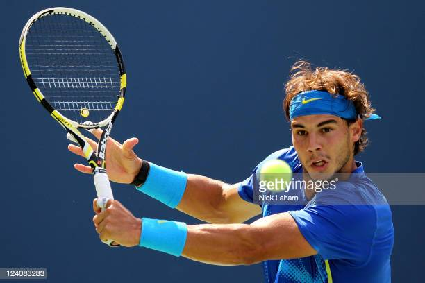 Rafael Nadal of Spain returns a shot against Gilles Muller of Luxembourg during Day Eleven of the 2011 US Open at the USTA Billie Jean King National...