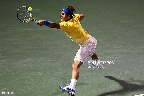 Rafael Nadal of Spain returns a shot against Jo-Wilfried Tsonga of France during day nine of the 2010 Sony Ericsson Open at Crandon Park Tennis...