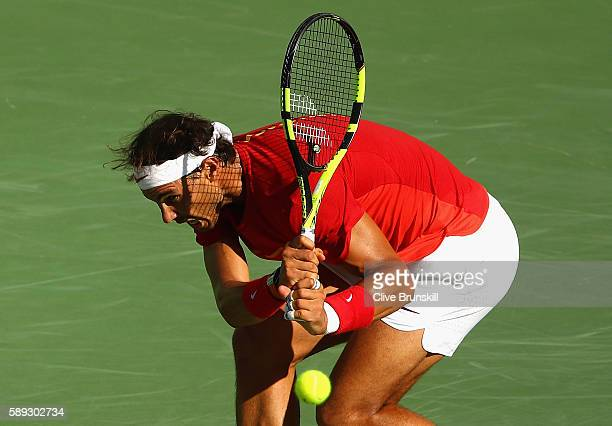 Rafael Nadal of Spain returns a shot against Juan Martin Del Potro of Argentina during the Men's Singles Semifinal Match on Day 8 of the Rio 2016...