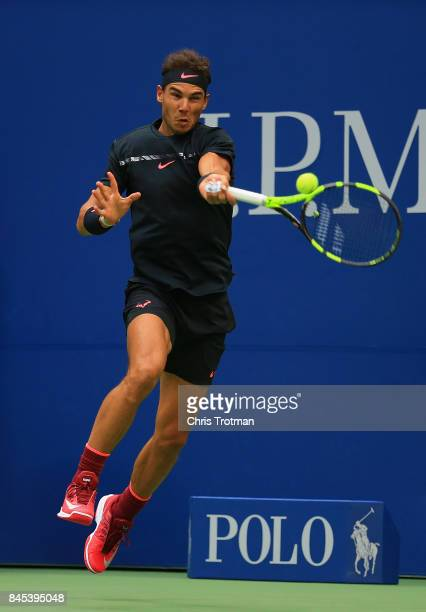 Rafael Nadal of Spain returns a shot against Kevin Anderson of South Africa during their Men's Singles finals match on Day Fourteen during the 2017...