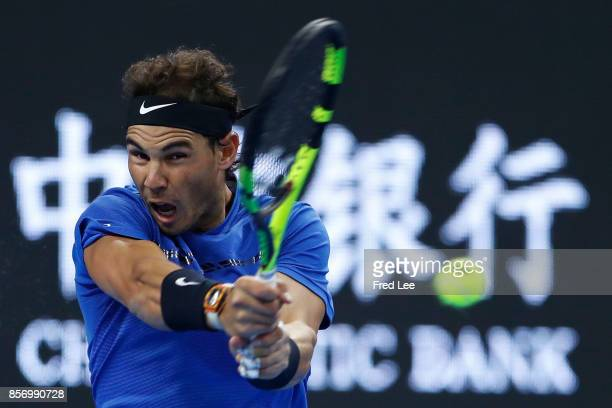 Rafael Nadal of Spain returns a shot against Lucas Pouille of France during the Men's singles first round on day four of 2017 China Open at the China...