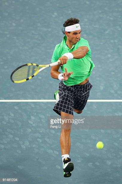 Rafael Nadal of Spain returns a shot against Marcos Baghdatis of Cyprus in his first round match during day five of the 2009 China Open at the...