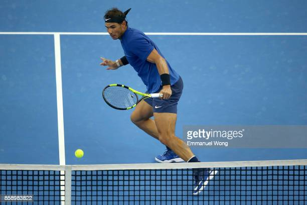 Rafael Nadal of Spain returns a shot against Nick Kyrgios of Australia during the Men's singles final match on day nine of the 2017 China Open at the...