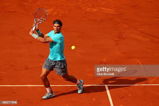 Rafael Nadal of Spain returns a shot during his men's singles final match against Novak Djokovic of Serbia on day fifteen of the French Open at...