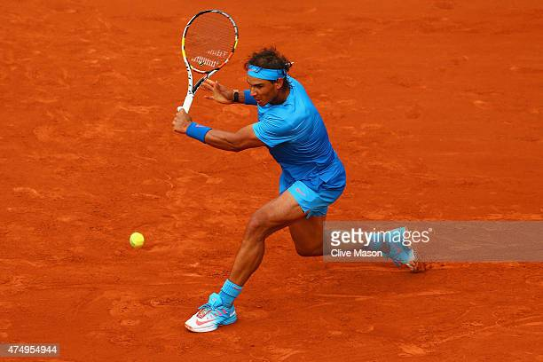 Rafael Nadal of Spain returns a shot during his Men's Singles match against Nicolas Almagro of Spain on day five of the 2015 French Open at Roland...