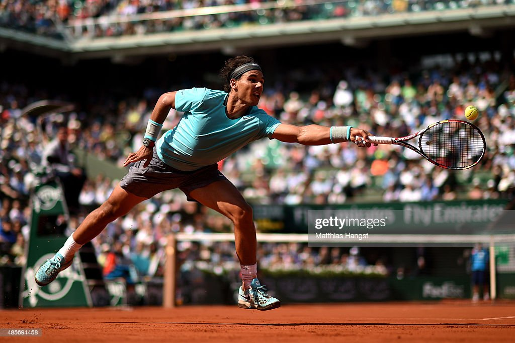 Rafael Nadal of Spain returns a shot during his men's singles match against Leonardo Mayer of Argentina on day seven of the French Open at Roland Garros on May 31, 2014 in Paris, France.