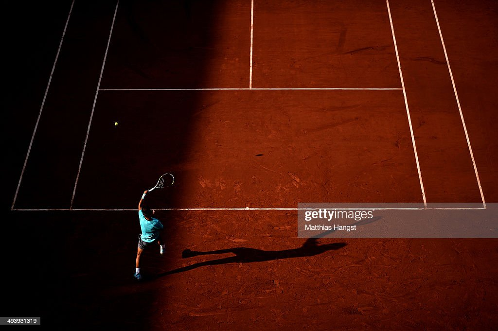 Rafael Nadal of Spain returns a shot during his men's singles match against Robby Ginepri of the United States on day two of the French Open at Roland Garros on May 26, 2014 in Paris, France.