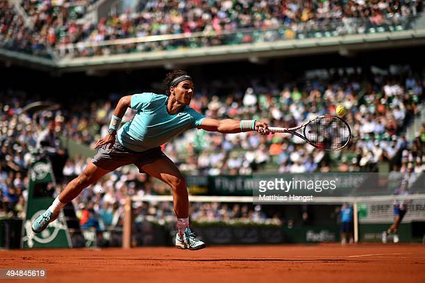 Rafael Nadal of Spain returns a shot during his men's singles match against Leonardo Mayer of Argentina on day seven of the French Open at Roland...