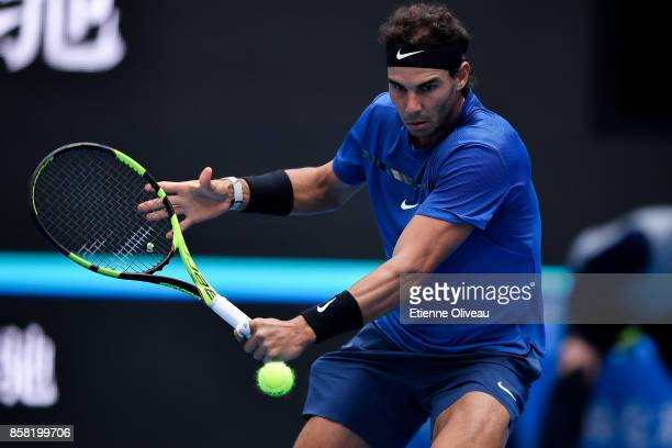 Rafael Nadal of Spain returns a shot during his Men's singles quarterfinal match against John Isner of the United States on day seven of the 2017...