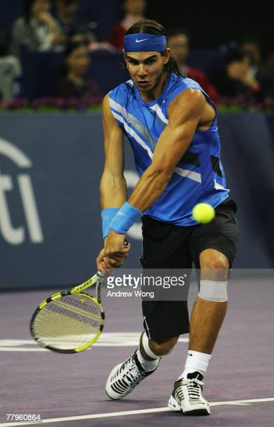 Rafael Nadal of Spain returns a shot during his semifinal match against Roger Federer of Switzerland in the Tennis Masters Cup at Qi Zhong Stadium on...
