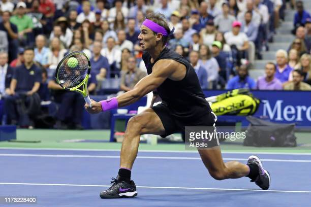 Rafael Nadal of Spain returns a shot during the fifth set of his Men's Singles final match against Daniil Medvedev of Russia on day fourteen of the...