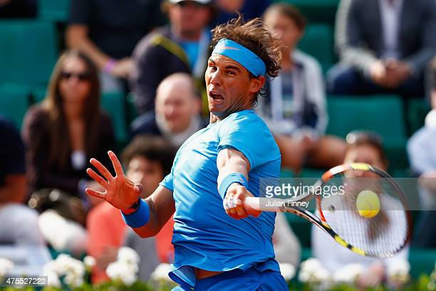 Rafael Nadal of Spain returns a shot in his Men's Singles match against Jack Sock of the United States on day nine of the 2015 French Open at Roland...