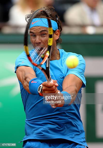 Rafael Nadal of Spain returns a shot in his Men's Singles match against Quentin Halys of France on day three of the 2015 French Open at Roland Garros...