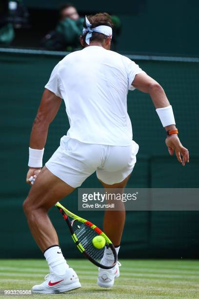 Rafael Nadal of Spain returns a shot through his legs against Alex De Minaur of Australia during their Men's Singles third round match on day six of...