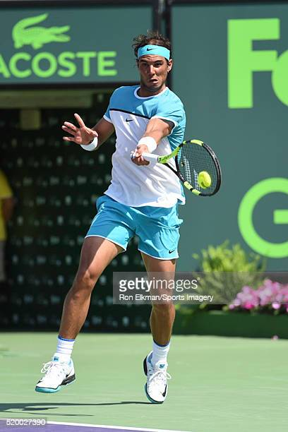 Rafael Nadal of Spain returns a shot to Damir Dzumhur of Bosnia and Herzegovina during the Miami Open presented by Itau at Crandon Park Tennis Center...