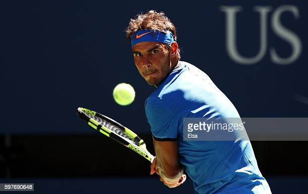 Rafael Nadal of Spain returns a shot to Denis Istomin of Uzbekistan during his first round Men's Singles match on Day One of the 2016 US Open at the...