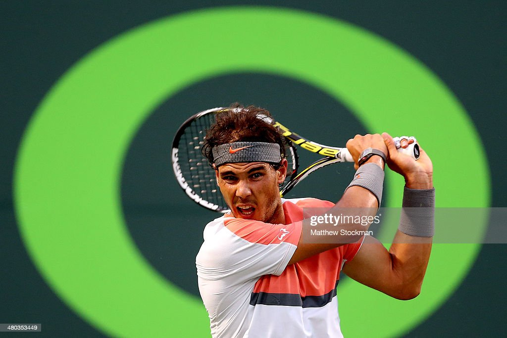 Rafael Nadal of Spain returns a shot to Denis Istomin of Uzebekistan during the Sony Open at the Crandon Park Tennis Center on March 24, 2014 in Key Biscayne, Florida.