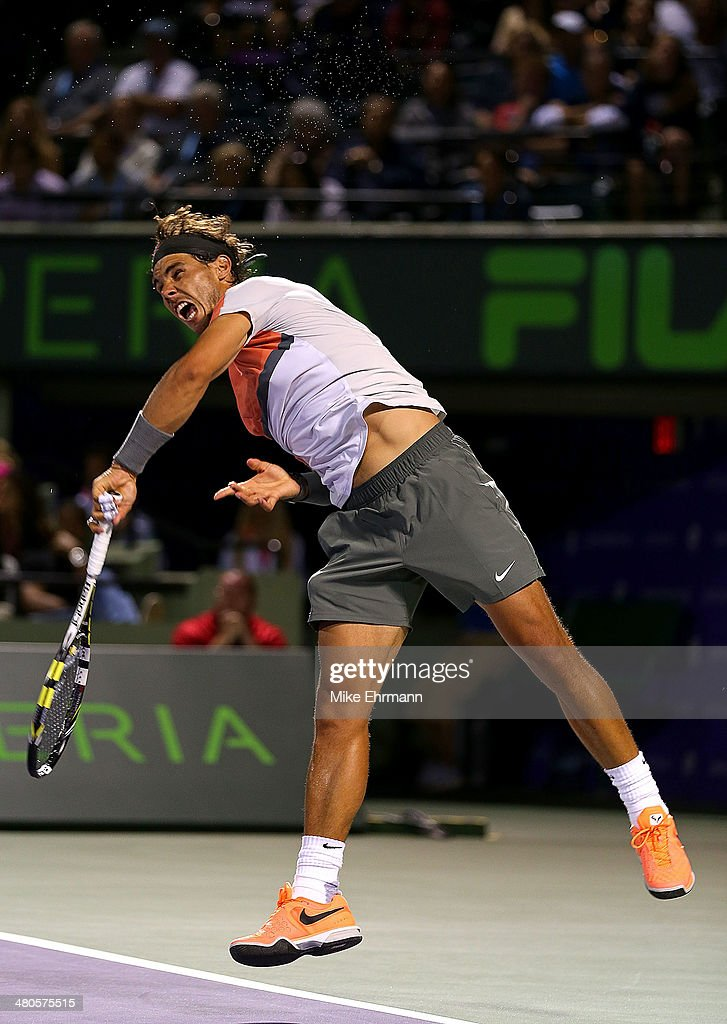 Rafael Nadal of Spain returns a shot to Fabio Fognini of italy during their match on Day 9 of the Sony Open at Carndon Park Tennis Center on March 25, 2014 in Key Biscayne, Florida.
