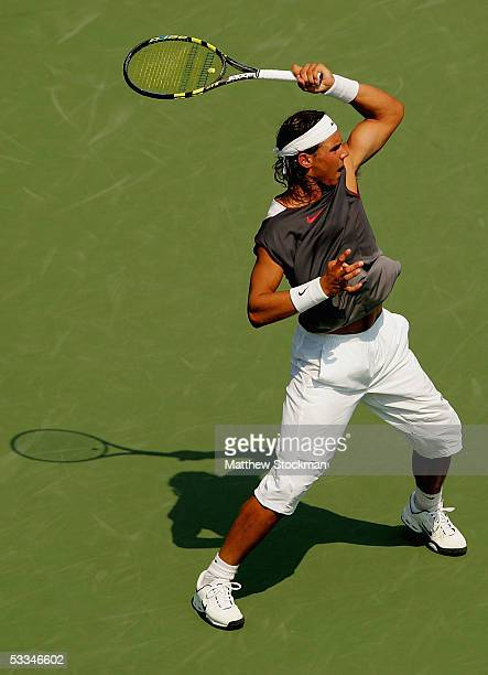 Rafael Nadal of Spain returns a shot to fellow countryman Carlos Moya in the first round of the ATP Rogers Cup Masters tennis tournament August 9,...