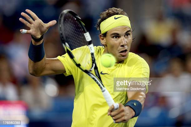 Rafael Nadal of Spain returns a shot to Grigor Dimitrov of Bulgaria during the Western Southern Open on August 15 2013 at Lindner Family Tennis...