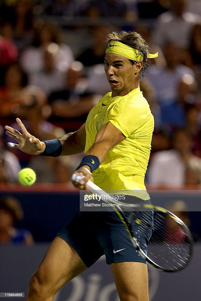 Rafael Nadal of Spain returns a shot to Marinko Matosevic of Australia during the Rogers Cup at Uniprix Stadium on August 9, 2013 in Montreal, Quebec, Canada.