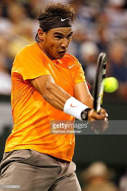 Rafael Nadal of Spain returns a shot to Somdev Devvarman of India during the BNP Paribas Open at the Indian Wells Tennis Garden on March 16, 2011 in...