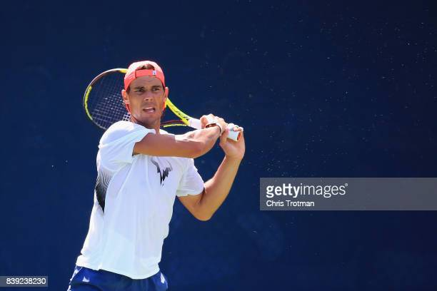 Rafael Nadal of Spain returns a shot while practicing prior to the start of the 2017 US Open at the USTA Billie Jean King National Tennis Center on...