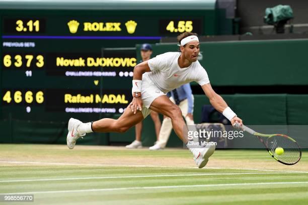 Rafael Nadal of Spain returns against Novak Djokovic of Serbia during their Men's Singles semifinal match on day twelve of the Wimbledon Lawn Tennis...