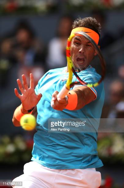 Rafael Nadal of Spain returns in his match against Felix AugerAliassime of Canada during day five of the Mutua Madrid Open at La Caja Magica on May...