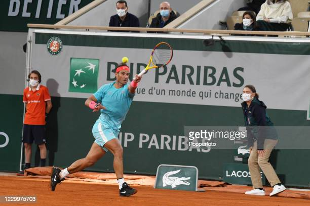 Rafael Nadal of Spain returns the ball against Novak Djokovic of Serbia during the men's singles final on day fifteen of the 2020 French Open at...