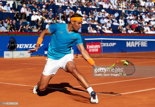 Rafael Nadal of Spain returns the ball during his Men's round of quarter-final match against Jan-Lennard Struff of Germany on day five of the...