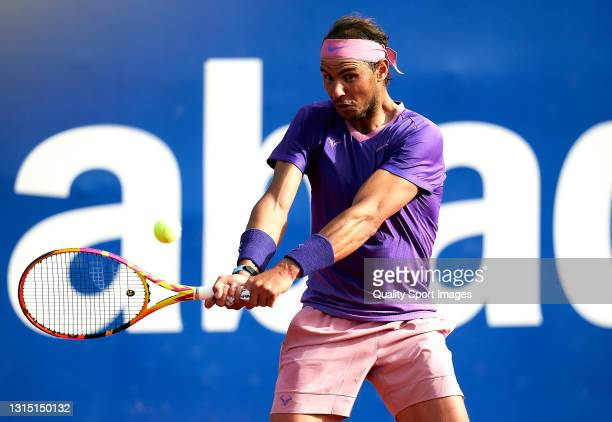 Rafael Nadal of Spain returns the ball during his Men's Singles final match against Stefanos Tsitsipas of Greece on day seven of the Barcelona Open...
