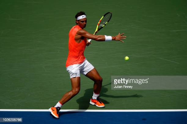 Rafael Nadal of Spain returns the ball during his men's singles fourth round match against Nikoloz Basilashvili of Georgia on Day Seven of the 2018...