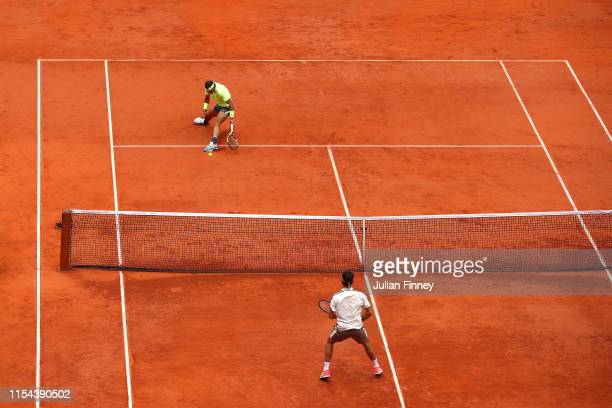Rafael Nadal of Spain returns the ball during his mens singles semi-final match against Roger Federer of Switzerland during Day thirteen of the 2019...