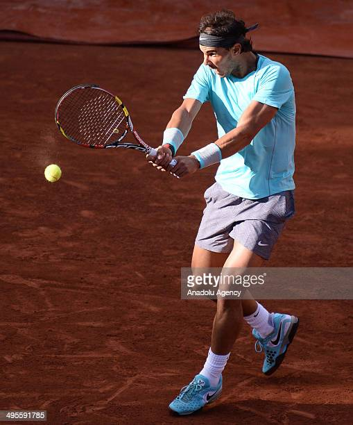 Rafael Nadal of Spain returns the ball to his compatriot David Ferrer during their quarter final match of the French Open tennis tournament at Roland...
