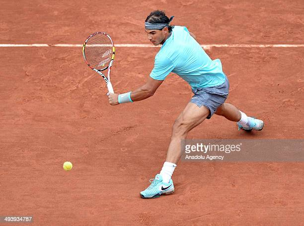 Rafael Nadal of Spain returns the ball to Robby Ginepri of United States in day two of the French Open tennis tournament at Roland Garros Stadium in...