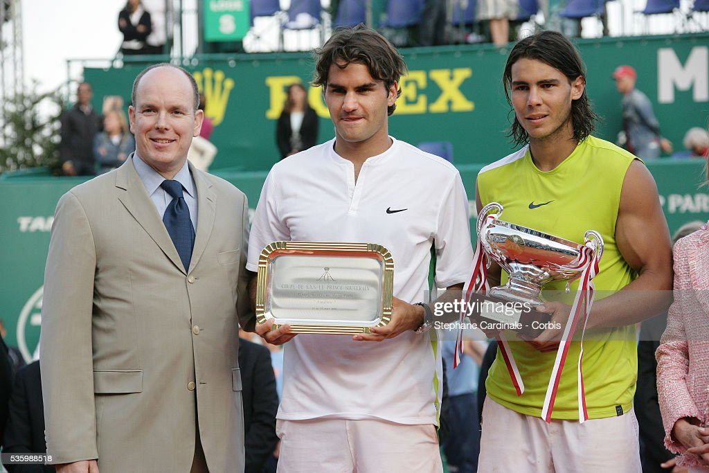 Rafael Nadal of Spain, right, Roger Federer of Switzerland, center, stand with Monaco's Prince Albert II after Nadal won the final match of the Monte Carlo Open Tennis tournament in Monaco. Nadal won 6-2, 6-7, 6-3, 7-6.